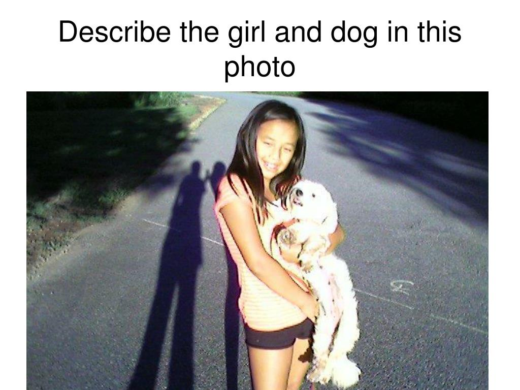 Describe the girl and dog in this photo