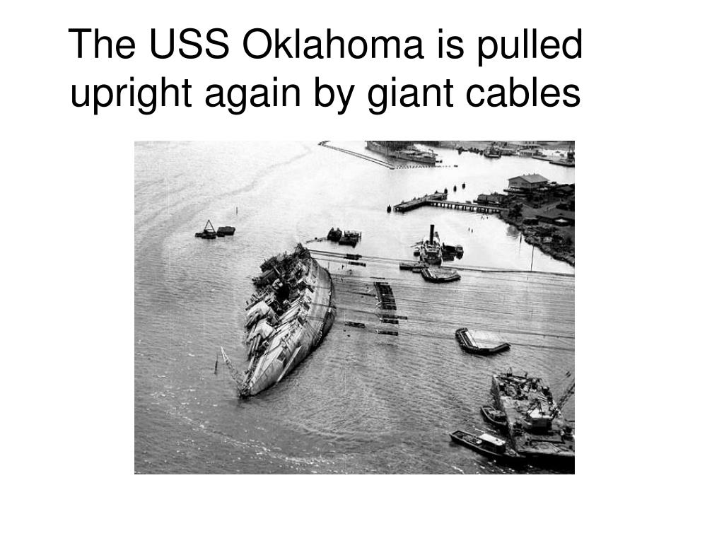 The USS Oklahoma is pulled upright again by giant cables
