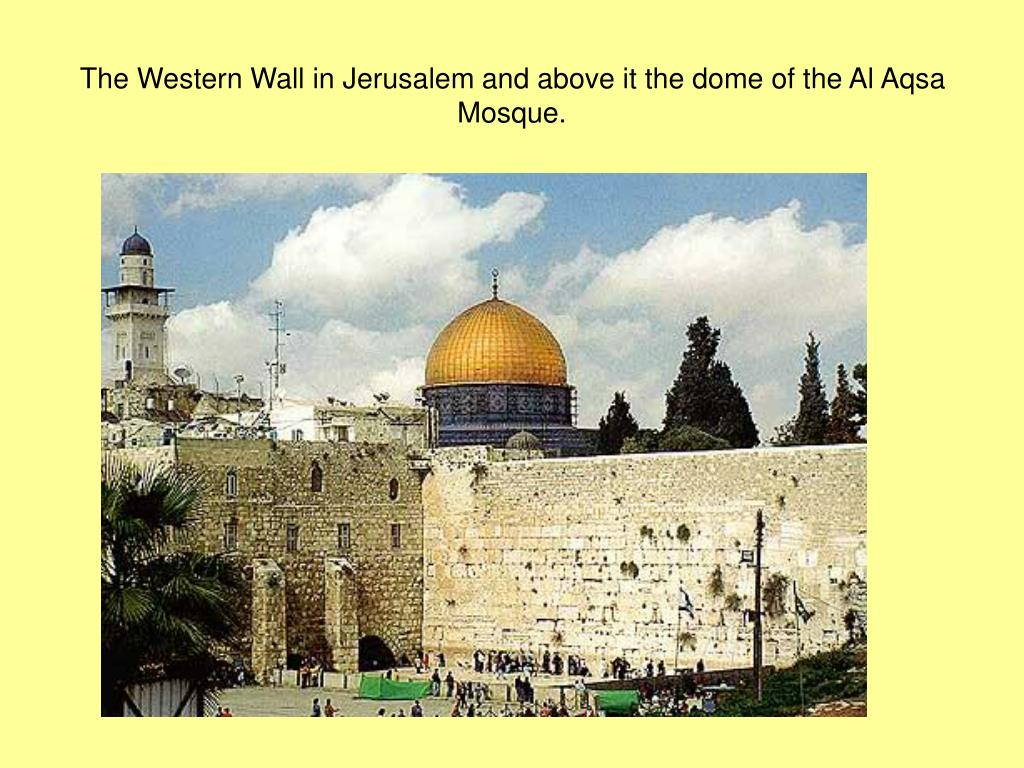 The Western Wall in Jerusalem and above it the dome of the Al Aqsa Mosque.