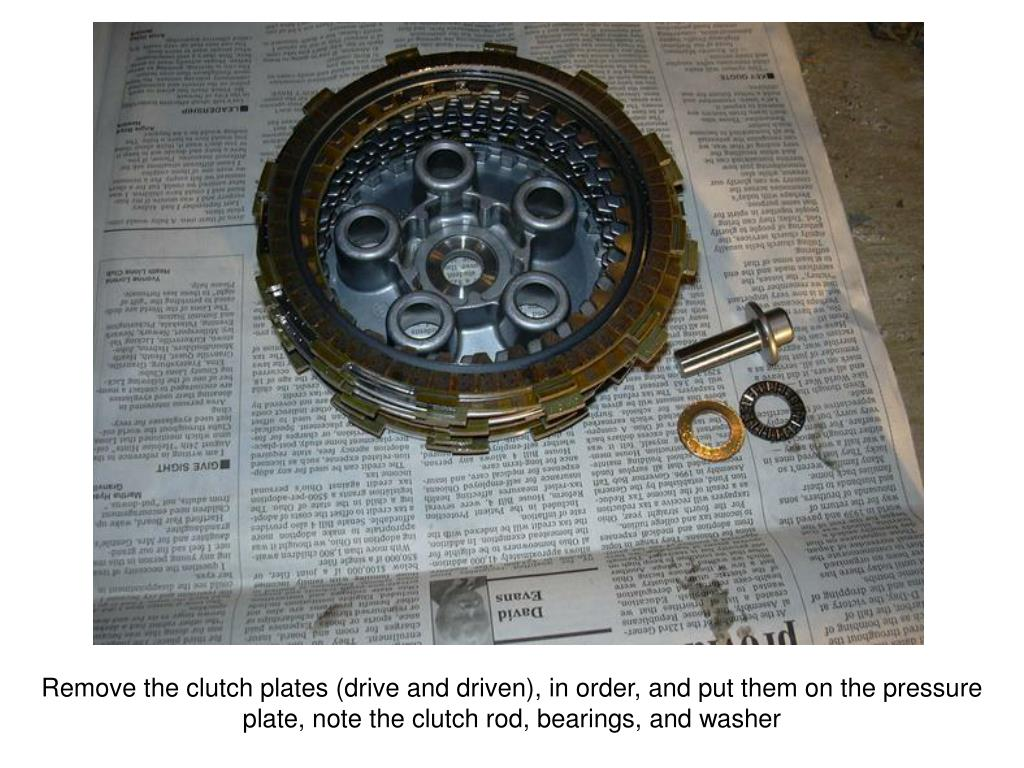 Remove the clutch plates (drive and driven), in order, and put them on the pressure plate, note the clutch rod, bearings, and washer