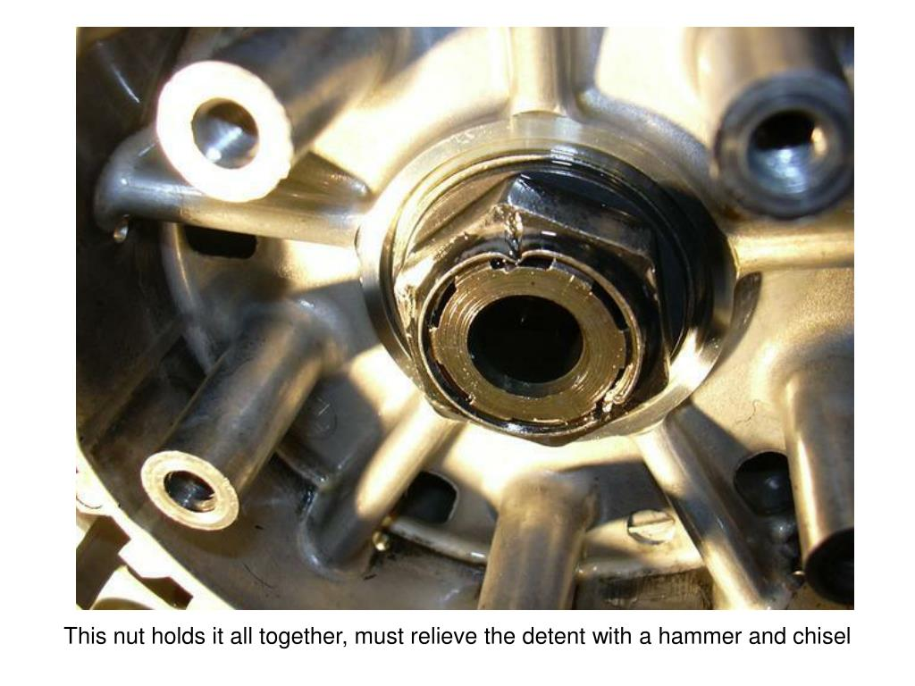 This nut holds it all together, must relieve the detent with a hammer and chisel