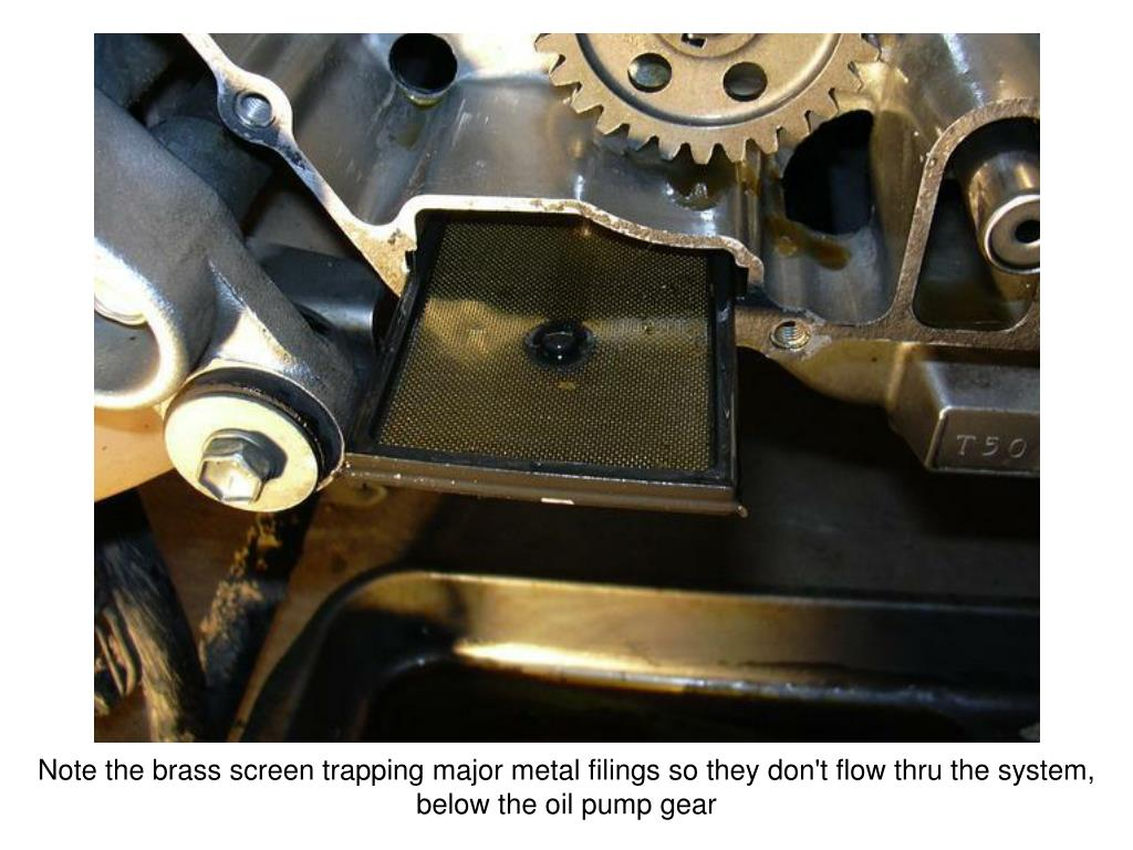 Note the brass screen trapping major metal filings so they don't flow thru the system, below the oil pump gear