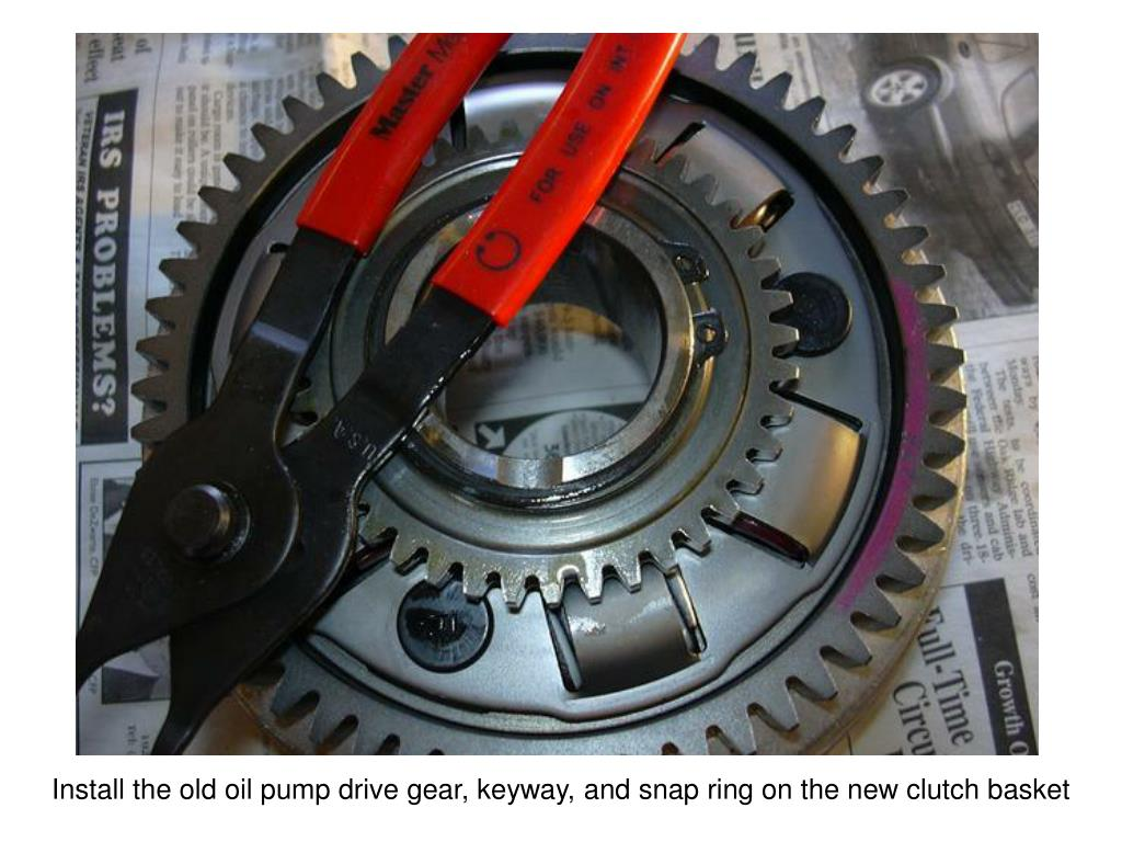 Install the old oil pump drive gear, keyway, and snap ring on the new clutch basket