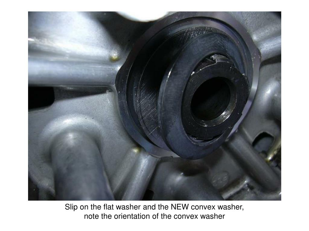 Slip on the flat washer and the NEW convex washer,