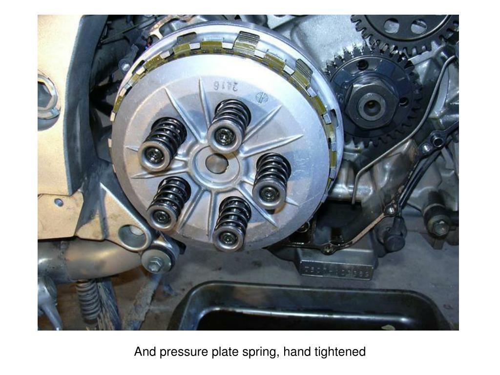 And pressure plate spring, hand tightened
