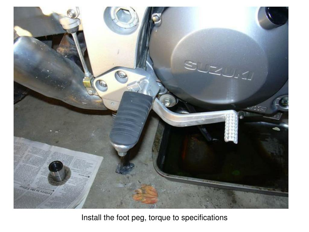 Install the foot peg, torque to specifications