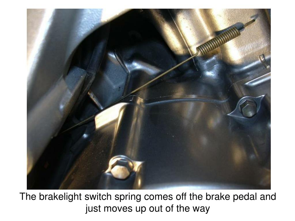 The brakelight switch spring comes off the brake pedal and just moves up out of the way