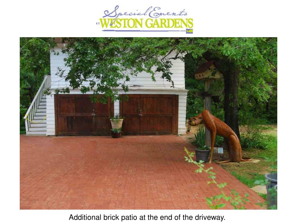 Additional brick patio at the end of the driveway.