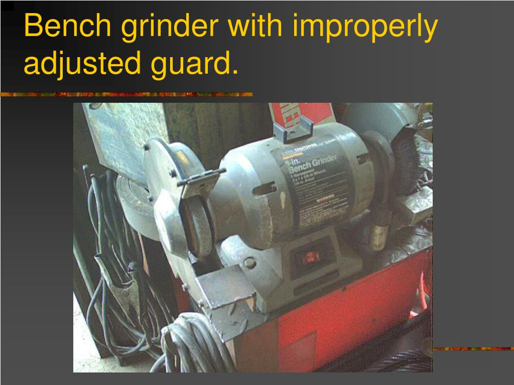 Bench grinder with improperly adjusted guard.