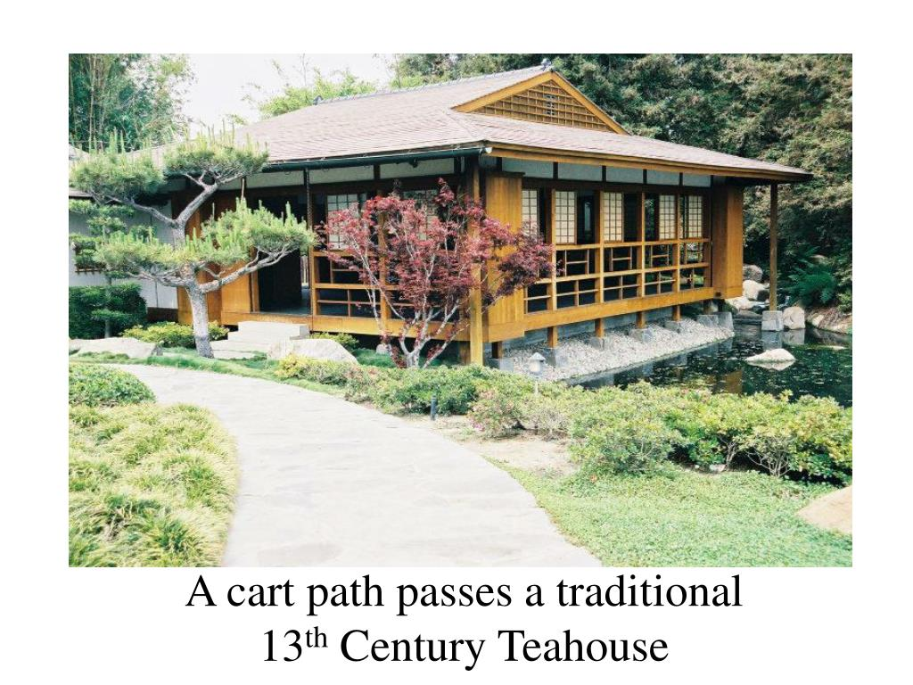 A cart path passes a traditional