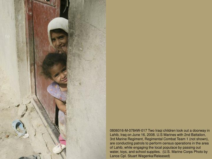0806016-M-0784W-017 Two Iraqi children look out a doorway in Lahib, Iraq on June 16, 2008. U.S Marin...