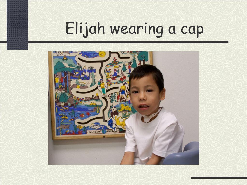 Elijah wearing a cap