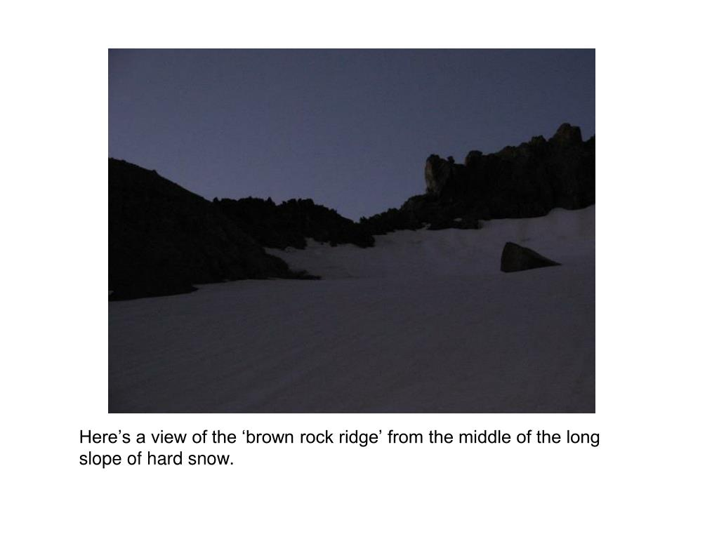 Here's a view of the 'brown rock ridge' from the middle of the long slope of hard snow.
