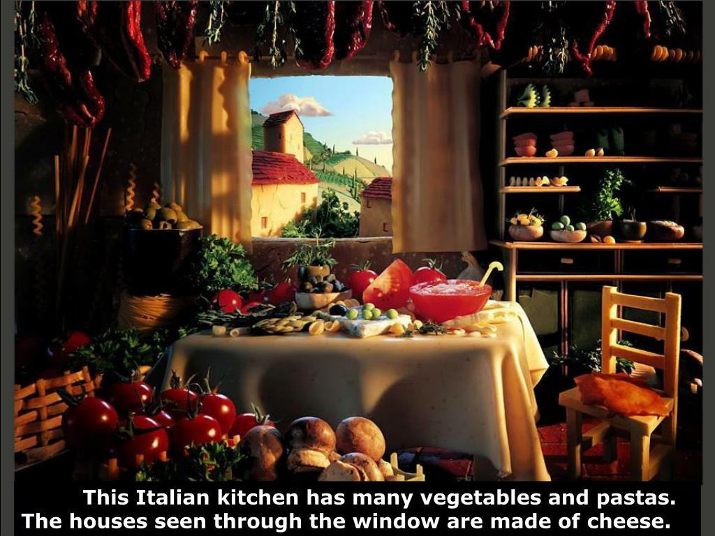This Italian kitchen has many vegetables and pastas. The houses seen through the window are made of cheese.