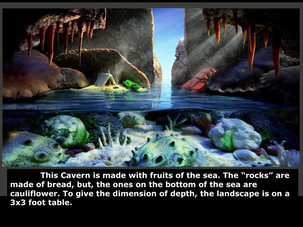 """This Cavern is made with fruits of the sea. The """"rocks"""" are made of bread, but, the ones on the bottom of the sea are cauliflower. To give the dimension of depth, the landscape is on a 3x3 foot table."""