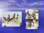 children at the beach building sand castles