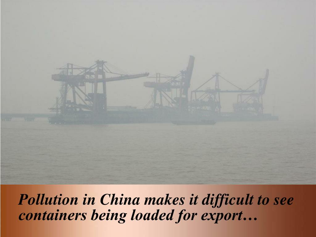 Pollution in China makes it difficult to see containers being loaded for export…