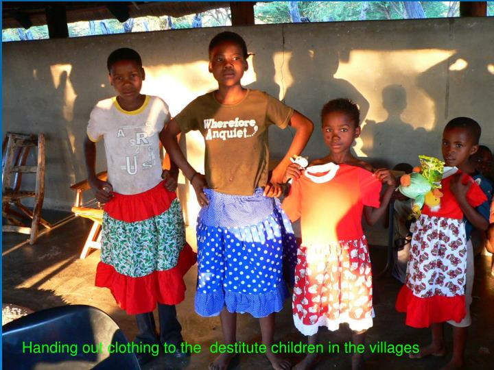 Handing out clothing to the  destitute children in the villages