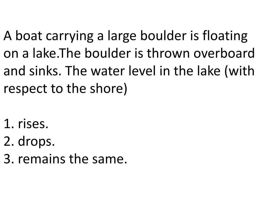 A boat carrying a large boulder is floating