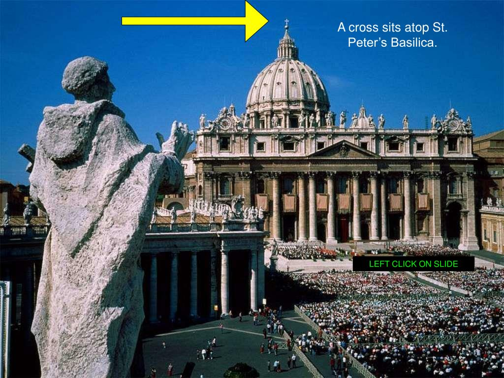 A cross sits atop St. Peter's Basilica.