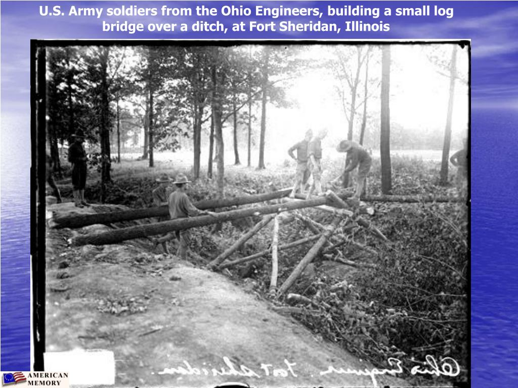 U.S. Army soldiers from the Ohio Engineers, building a small log bridge over a ditch, at Fort Sheridan, Illinois