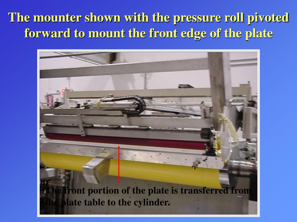 The mounter shown with the pressure roll pivoted forward to mount the front edge of the plate