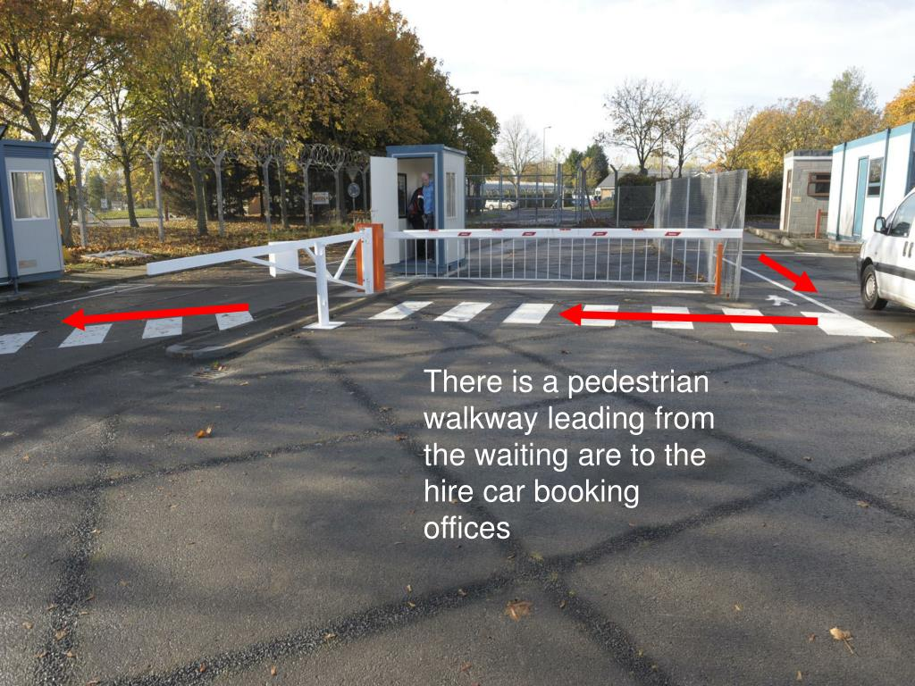 There is a pedestrian walkway leading from the waiting are to the hire car booking offices