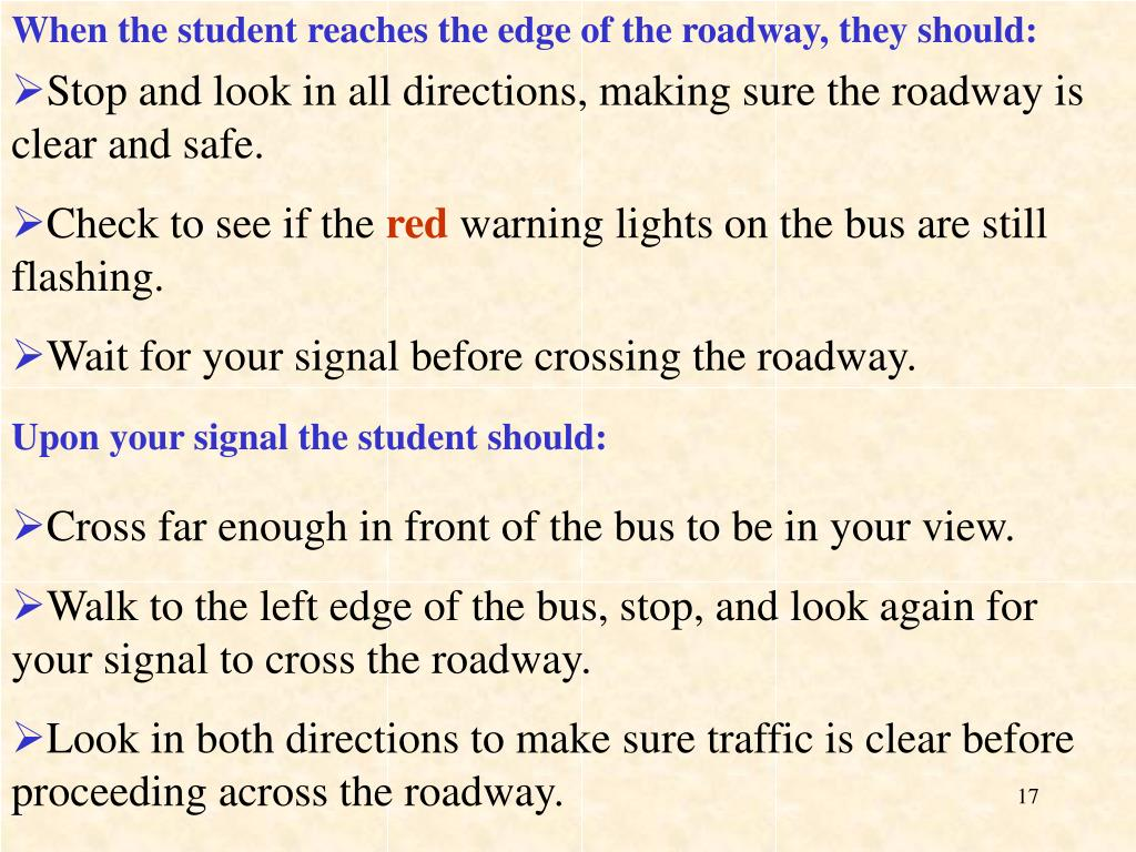 When the student reaches the edge of the roadway, they should: