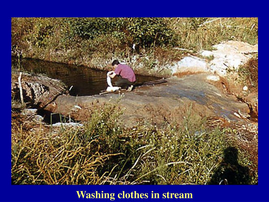Washing clothes in stream