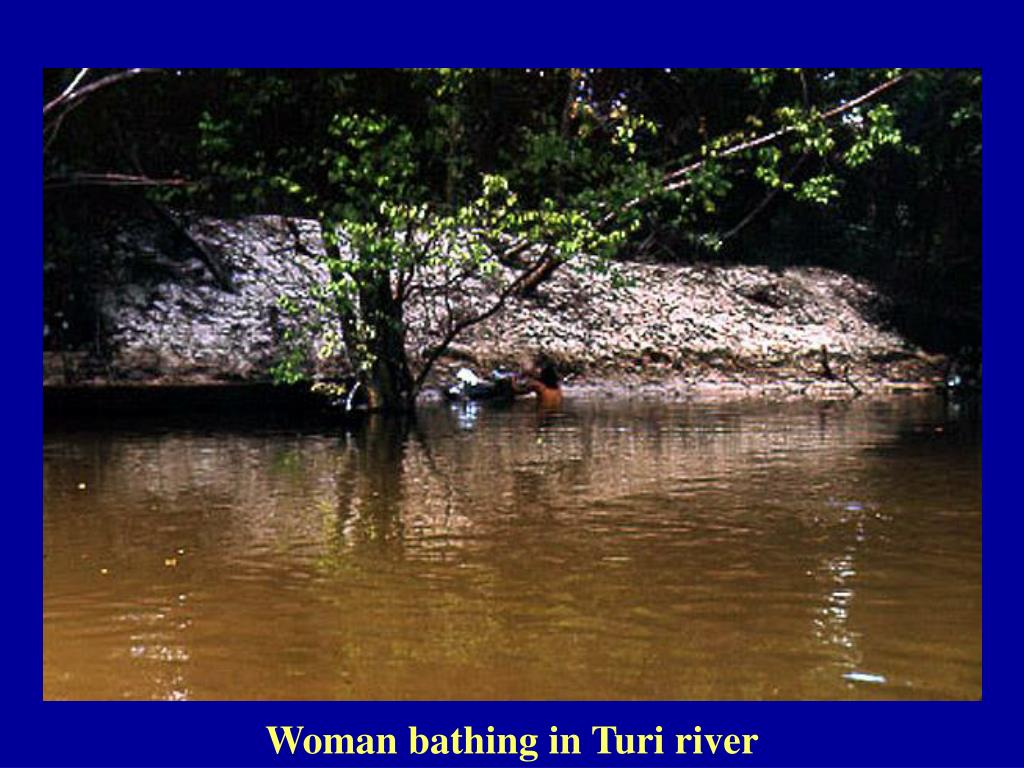 Woman bathing in Turi river