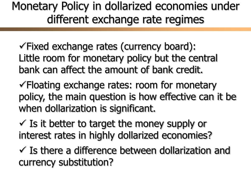 Monetary Policy in dollarized economies under different exchange rate regimes