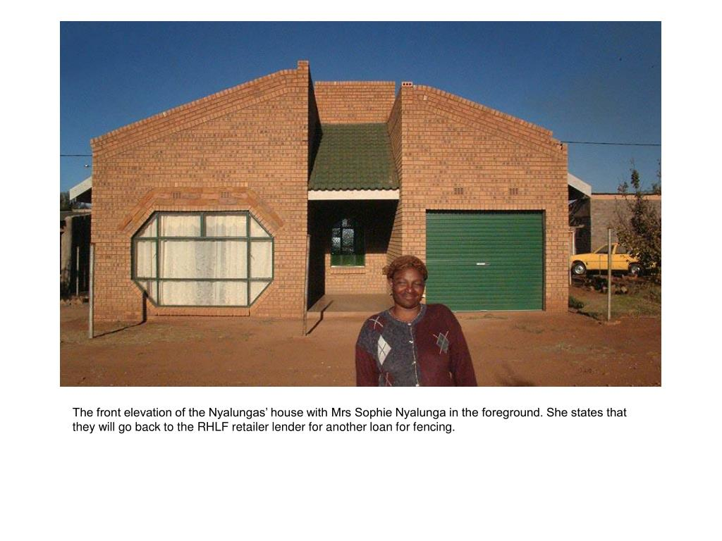 The front elevation of the Nyalungas' house with Mrs Sophie Nyalunga in the foreground. She states that they will go back to the RHLF retailer lender for another loan for fencing.