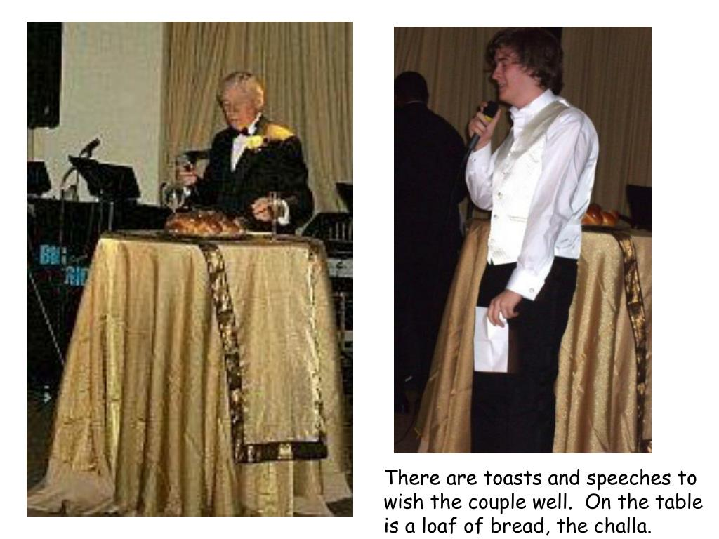 There are toasts and speeches to wish the couple well.  On the table is a loaf of bread, the challa.