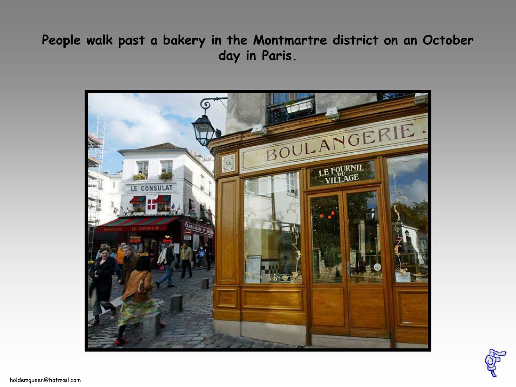 People walk past a bakery in the Montmartre district on an October day in Paris.