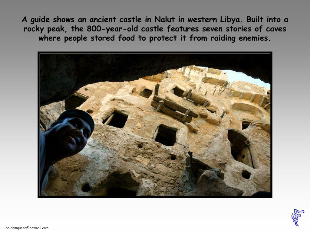 A guide shows an ancient castle in Nalut in western Libya. Built into a rocky peak, the 800-year-old castle features seven stories of caves where people stored food to protect it from raiding enemies.