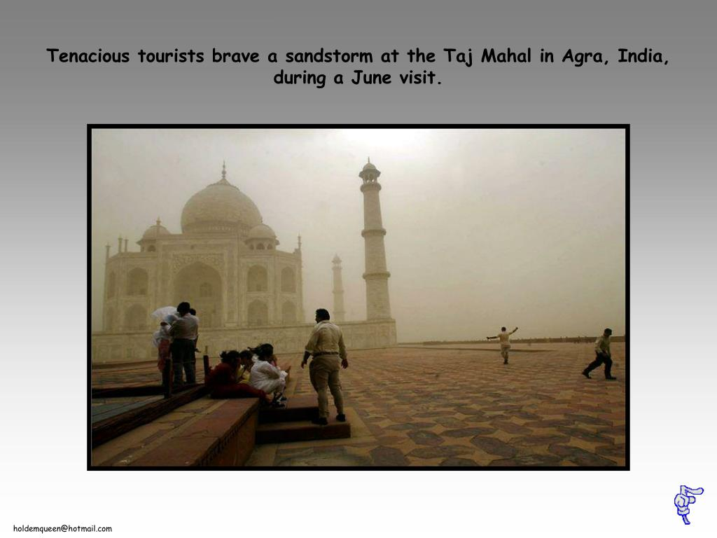 Tenacious tourists brave a sandstorm at the Taj Mahal in Agra, India, during a June visit.