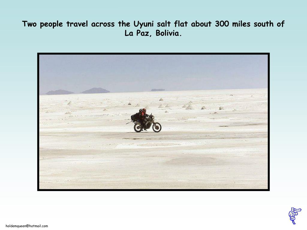 Two people travel across the Uyuni salt flat about 300 miles south of La Paz, Bolivia.