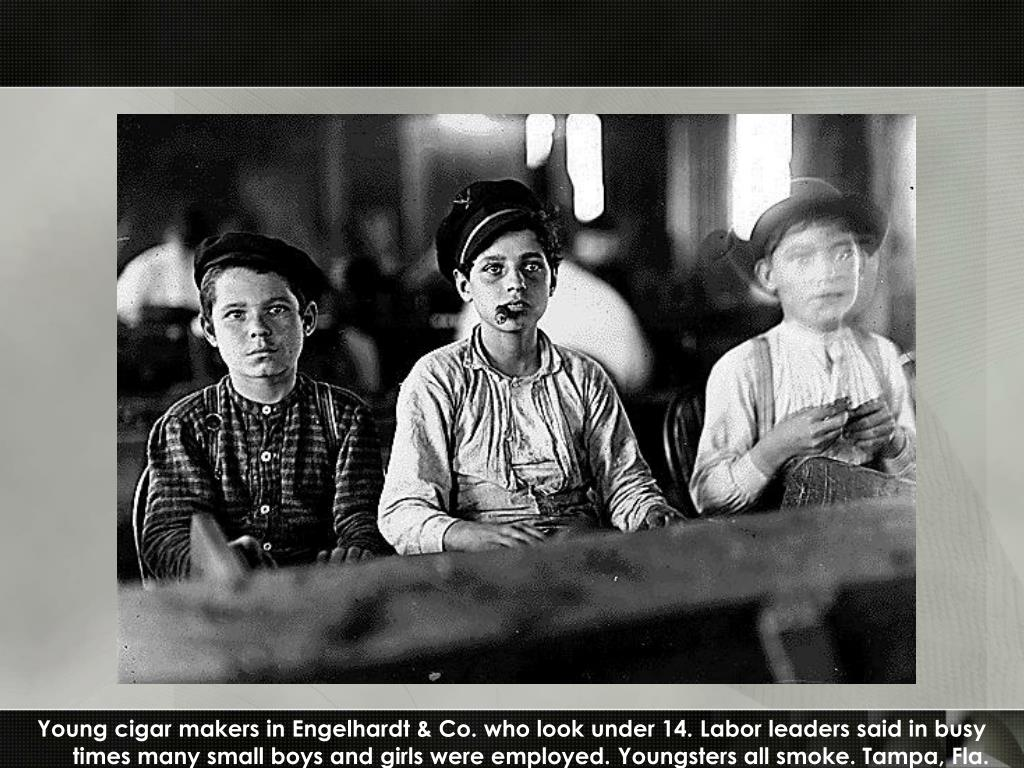 Young cigar makers in Engelhardt & Co. who look under 14. Labor leaders said in busy times many small boys and girls were employed. Youngsters all smoke. Tampa, Fla.