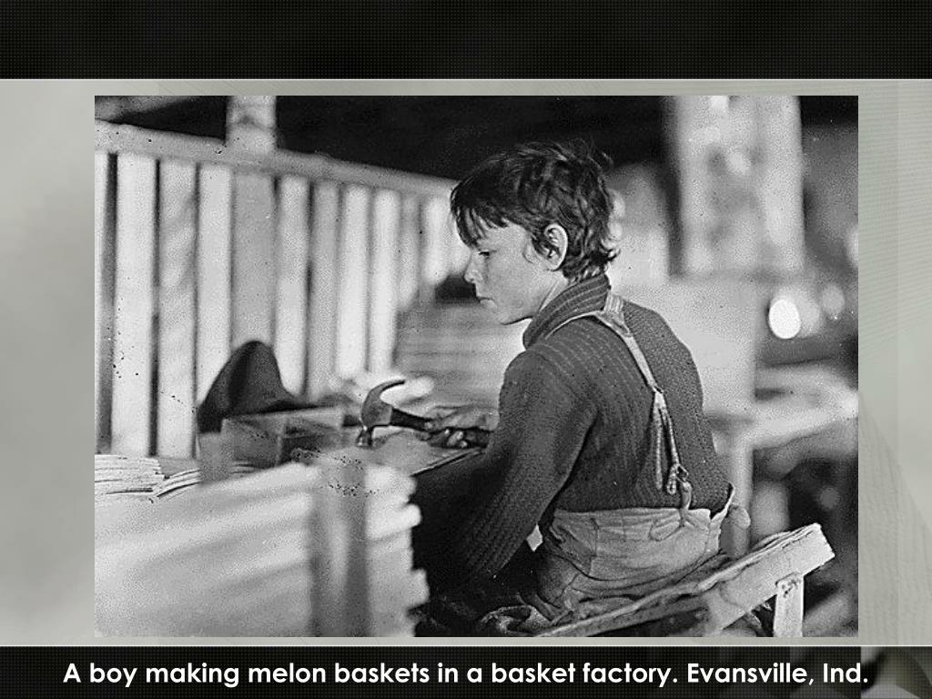 A boy making melon baskets in a basket factory. Evansville, Ind.