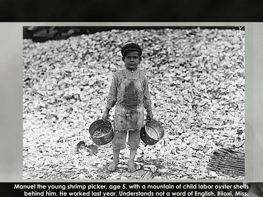 Manuel the young shrimp picker, age 5, with a mountain of child labor oyster shells
