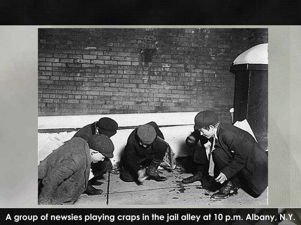A group of newsies playing craps in the jail alley at 10 p.m. Albany, N.Y.
