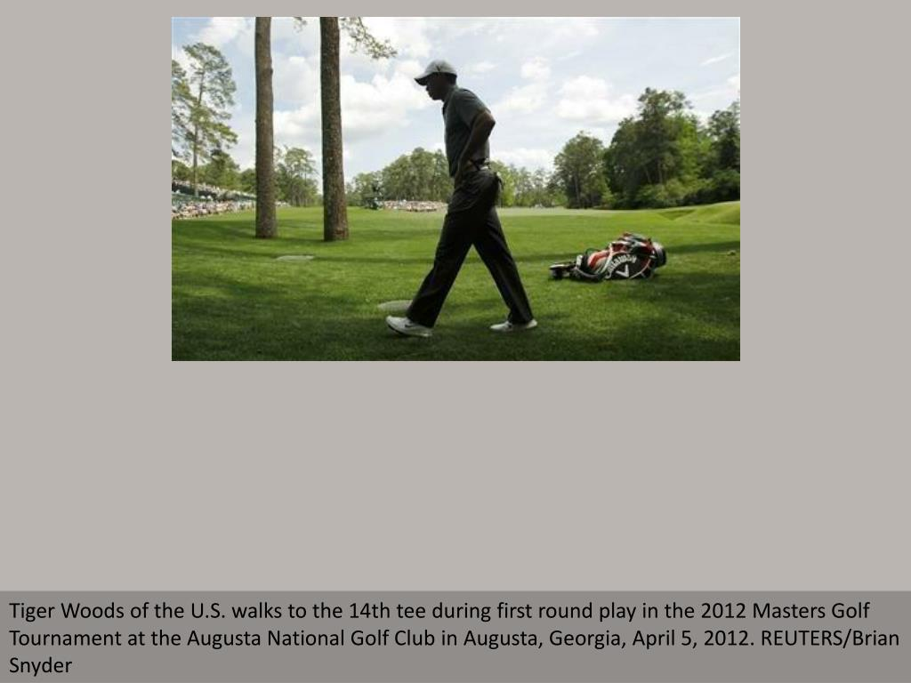 Tiger Woods of the U.S. walks to the 14th tee during first round play in the 2012 Masters Golf Tournament at the Augusta National Golf Club in Augusta, Georgia, April 5, 2012. REUTERS/Brian Snyder