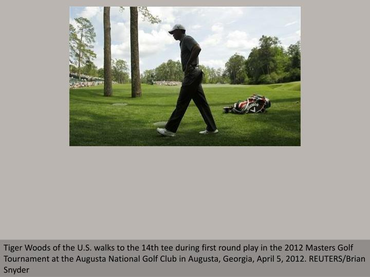 Tiger Woods of the U.S. walks to the 14th tee during first round play in the 2012 Masters Golf Tourn...