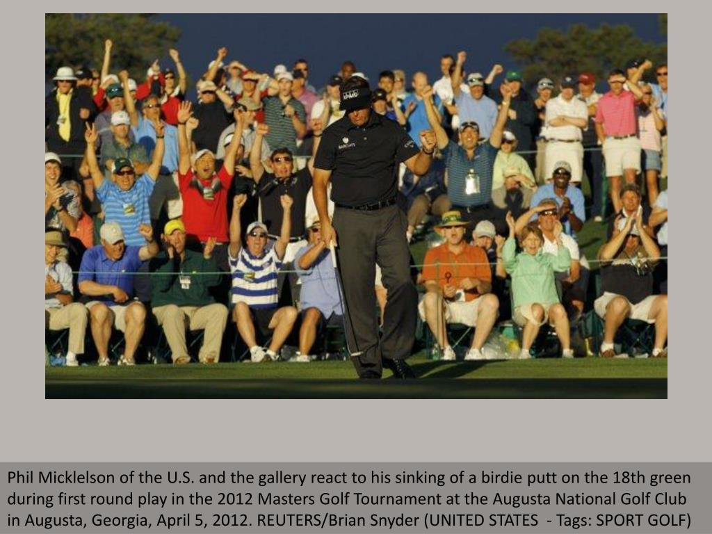 Phil Micklelson of the U.S. and the gallery react to his sinking of a birdie putt on the 18th green during first round play in the 2012 Masters Golf Tournament at the Augusta National Golf Club in Augusta, Georgia, April 5, 2012. REUTERS/Brian Snyder (UNITED STATES  - Tags: SPORT GOLF)