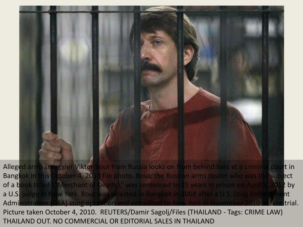 """Alleged arms smuggler Viktor Bout from Russia looks on from behind bars at a criminal court in Bangkok in this October 4, 2010 file photo. Bout, the Russian arms dealer who was the subject of a book titled \""""Merchant of Death,\"""" was sentenced to 25 years in prison on April 5, 2012 by a U.S. judge in New York. Bout was arrested in Bangkok in 2008 after a U.S. Drug Enforcement Administration (DEA) sting operation and extradited to New York in November 2010 to face trial. Picture taken October 4, 2010.  REUTERS/Damir Sagolj/Files (THAILAND - Tags: CRIME LAW) THAILAND OUT. NO COMMERCIAL OR EDITORIAL SALES IN THAILAND"""