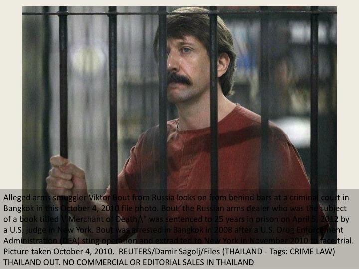 Alleged arms smuggler Viktor Bout from Russia looks on from behind bars at a criminal court in Bangk...
