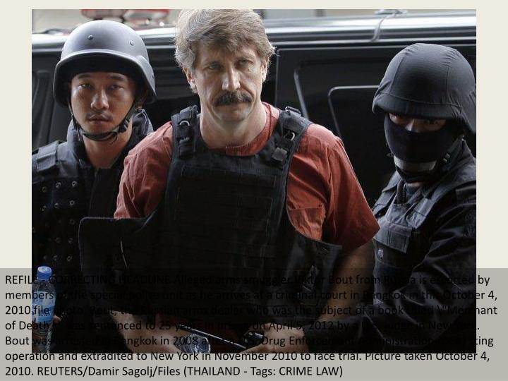 REFILE - CORRECTING HEADLINE Alleged arms smuggler Viktor Bout from Russia is escorted by members of...