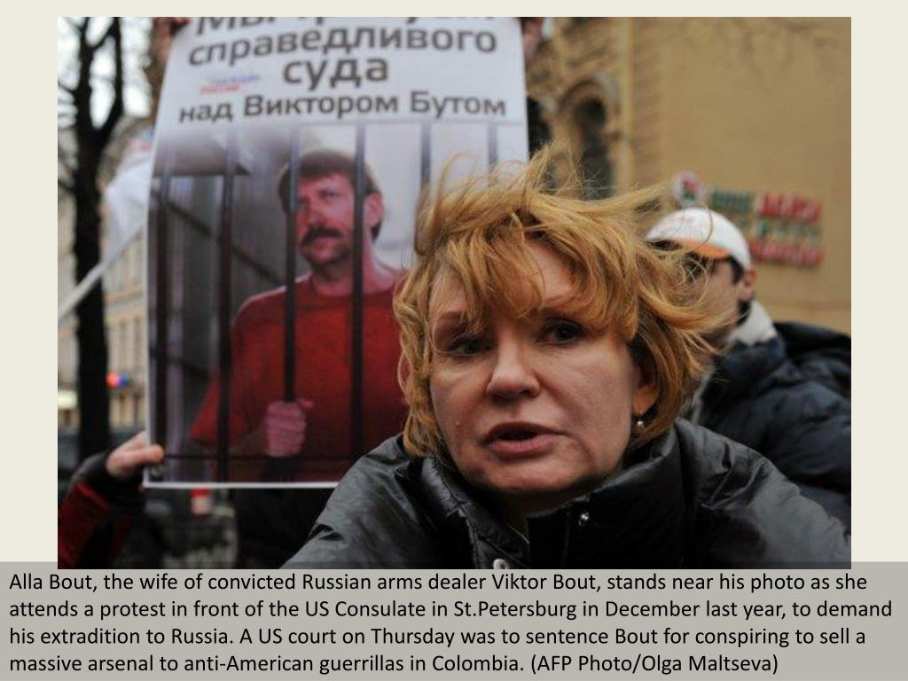 Alla Bout, the wife of convicted Russian arms dealer Viktor Bout, stands near his photo as she attends a protest in front of the US Consulate in St.Petersburg in December last year, to demand his extradition to Russia. A US court on Thursday was to sentence Bout for conspiring to sell a massive arsenal to anti-American guerrillas in Colombia. (AFP Photo/Olga Maltseva)