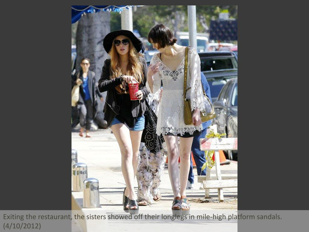 Exiting the restaurant, the sisters showed off their longlegs in mile-high platform sandals. (4/10/2012)