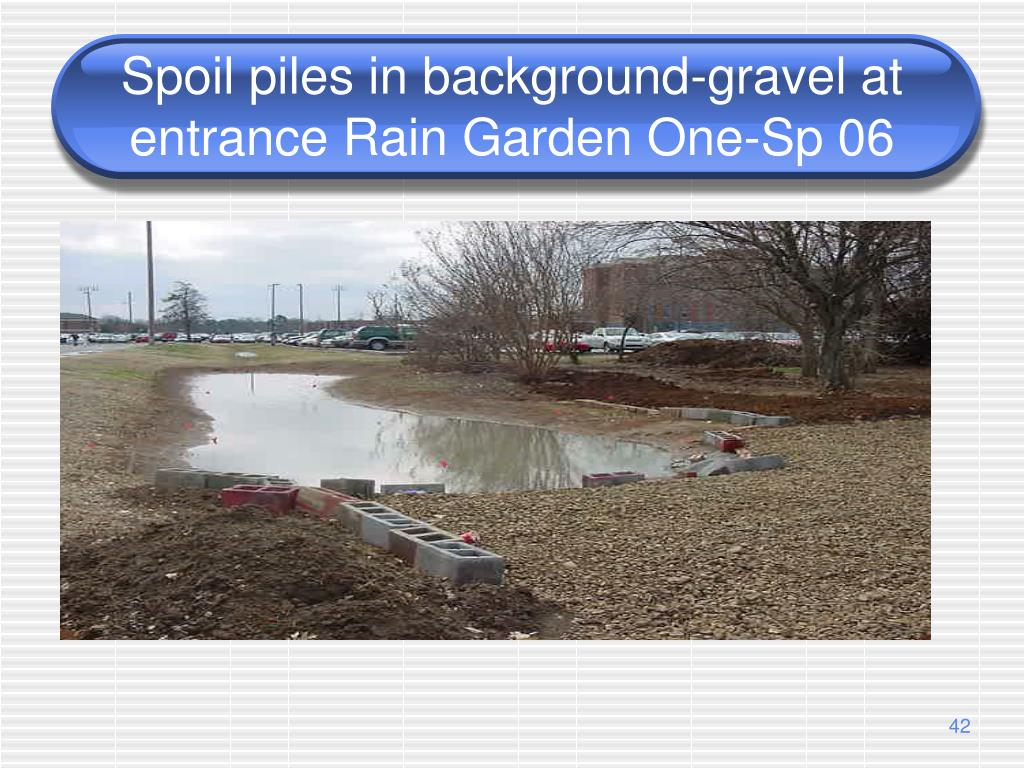 Spoil piles in background-gravel at entrance Rain Garden One-Sp 06